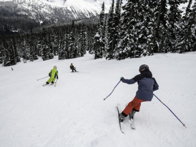 Family skiing with a Mountain Host in Whistler Blackcomb.